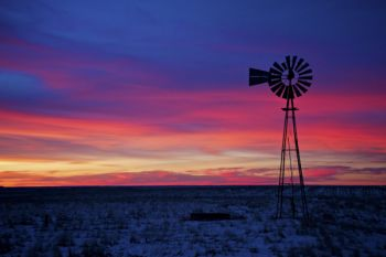Pre-sunrise colors and a lone windmill on a chilly morning in Dewey County.
