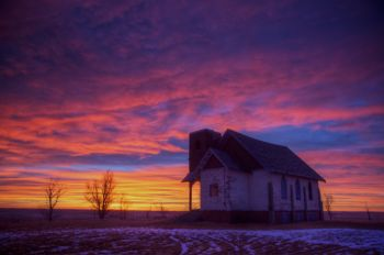 More colorful sunrise skies above an abandoned country church northeast of Firesteel.