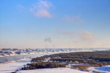 Steam from the open water rises in the Missouri River valley above the Oahe Downstream park area.
