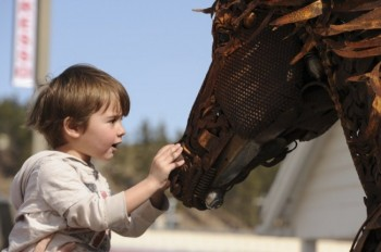 A boy marvels at &ldquo;Iron Star&rdquo; by <a href='http://www.lopez-ranch.net/' target='_blank'>John Lopez</a>. Photo by Bernie Hunhoff. Click to enlarge photo.