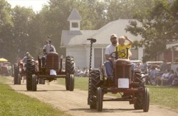 Tractors on parade at Madison's Prairie Village. Photo courtesy of the South Dakota Department of Tourism.