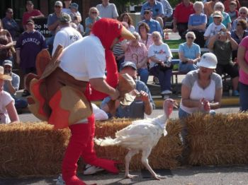 Huron's turkey handlers are not allowed to touch their racing turkeys, but may coax them to victory using other methods.