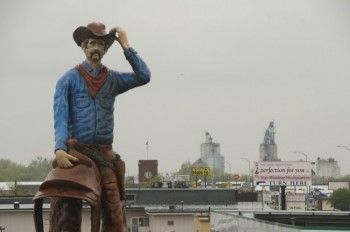 A giant cowboy watches over Watertown.