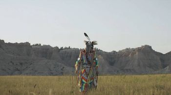 Adrian Primeaux wears traditional grass dance regalia during a video shoot in the Badlands.
