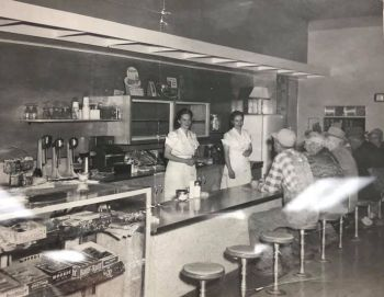 Irene Antonen (left) and Vi Andrews inside the Andrews Cafe in Lake Norden in the 1950s.