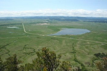 Camping and fishing are available at Bear Butte Lake just across Highway 79.