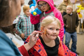 Face painting at the Fall Festival.