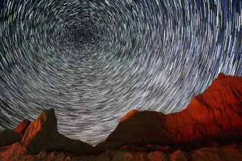 Multiple images combined of the stars above the Badlands show star trails as they move around Polaris (The North Star) in the northern sky.
