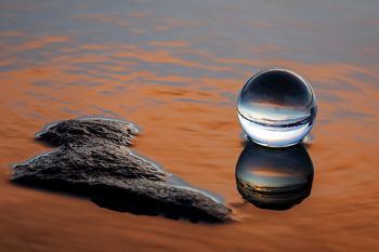 The lens ball resting on a rock on the edge of Lake Vermillion just after sunset.