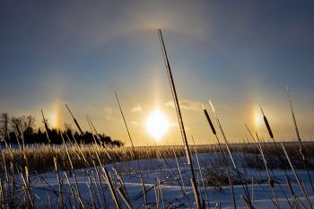 Sun dog sunset after a ground blizzard abated west of Sioux Falls.