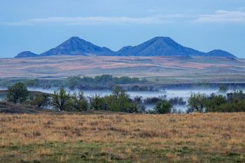 Deers Ears Buttes with early morning fog over the south fork of the Moreau River.