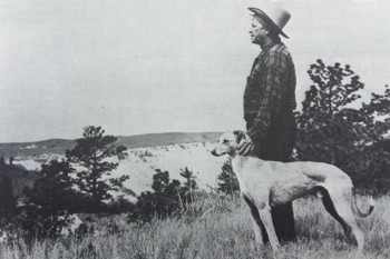 Berry with his greyhound at his side, gazing over his Badlands ranch.