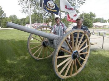 Jim Tapken and Walter Borkowski, members of Willman-Fee Post #14 of the American Legion, stand next to the newly-restored cannon. Photo by Duke Wenzel, <i>True Dakotan</i>.
