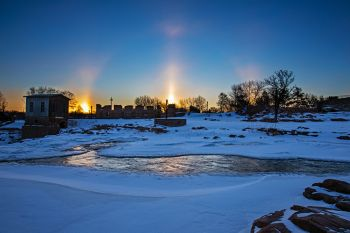 Sunrise sundogs above Falls Park in Sioux Falls.