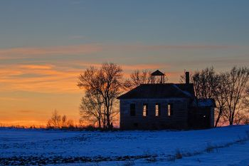 An abandoned country school at sunset in Union County.