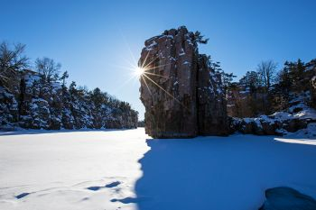 Sunburst and snow at Palisades State Park.