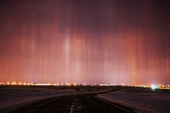 Light pillars above Sioux Falls looking south-southeast from the University Center.