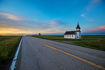 Peace Valley Church at dusk along Highway 79 in northeast Harding County.