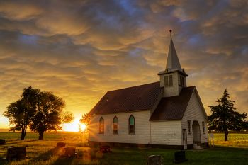 Trinity Lutheran near Platte as the first light after the storm broke through.