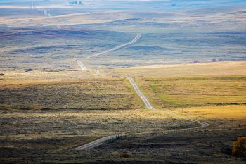 The JB Pass Road as it winds westward into the high plains beyond the Slim Buttes.