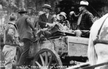 President Coolidge in a lumber wagon.
