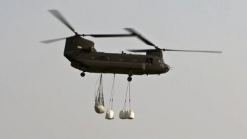 While these CH-47 Chinook helicopters worked with one-ton sandbags, the average sandbag weighs just 30 pounds.