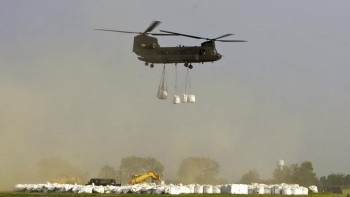 The CH-47 Chinook helicopters could lift several one-ton sandbags.