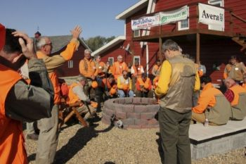 Father Vogel prays over the hunters before the hunt begins.