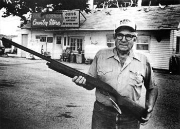 Curt Carter stands in front of the country gas station that he has turned into one of the region's foremost gun shops.