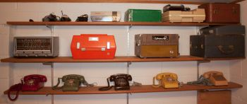 An eclectic mix of telephones and other nostalgic items decorate his basement studio.