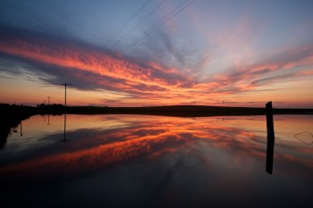 If you want a great sunset, visit the prairie pothole along Highway 20 east of Prairie City, South Dakota.
