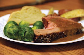 Bad memories of eating lamb will quickly vanish after sampling this roast lamb with coffee-brandy sauce.