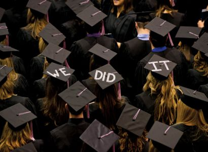 Graduates coordinated an enthusiastic message at a South Dakota State University ceremony. Photo by Greg Latza.