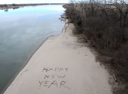 A New Year s greeting is drawn on the Missouri River beach near Yankton.
