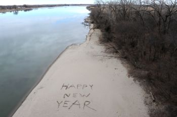 A New Year's greeting is drawn on the Missouri River beach near Yankton.