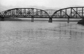 The Chicago and Northwestern Railroad bridge and the old highway bridge between Pierre and Fort Pierre marked the end of the raft journey.