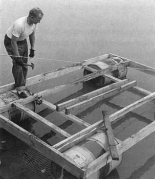 Tom Kilian constructed the raft for the trip out of a few old 30-gallon metal drums and some green cottonwood rafters.