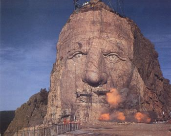 The morning sun illuminates the nearly completed face of the Crazy Horse sculpture, shown here in 1995, three years before its completion.