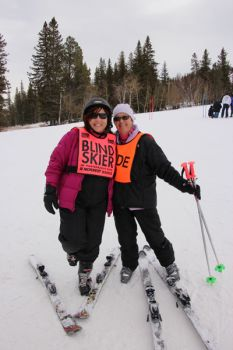 Sherry DeFrancesco, North Dakota, with guide Deb Tinker from Lead at Black Hills Ski for Light 2013. DeFrancesco will marry Jesse Shirek at Wednesday night's bonfire.