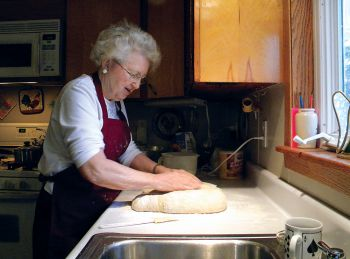 Timber Lake's Mary Biegler was photographed making caramel rolls for the cover of the 2010 Holiday Cookbook.