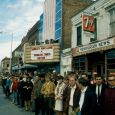 This 1967 photo shows University of South Dakota Students watching for the Dakota Days Parade in front of the old Co-Ed Theater (now Coyote Twin).