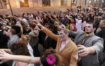 Hundreds of zombies gather outside the federal courthouse on
